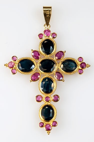 Gold cross with pink and blue sapphires