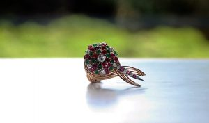 historical space age jewelry: Sputnik ring in gold, diamonds, emeralds and rubies