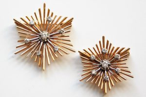 set of 18K gold and diamond snowflake brooches